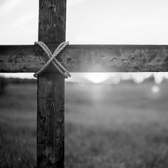 Cross against sunset