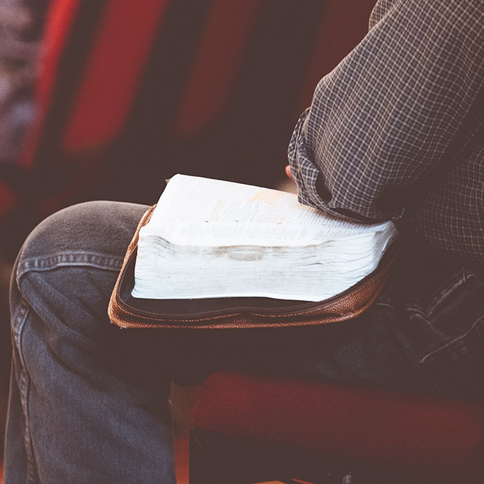 Man in church with open bible
