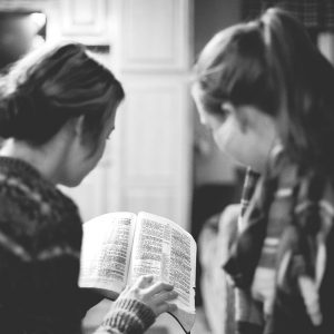 women studying bible