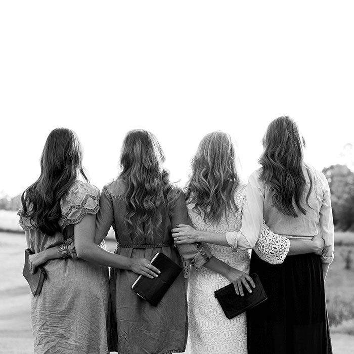 women holding bibles