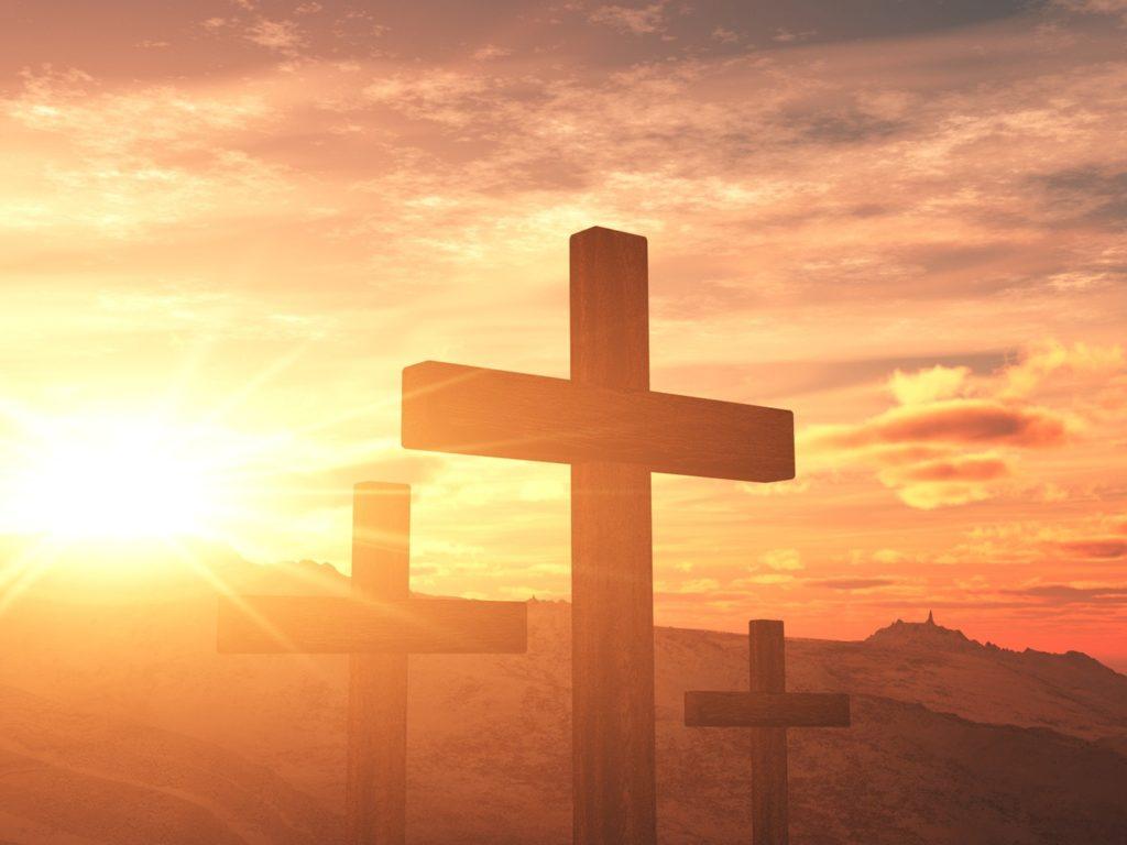 cross-design-christian-background-setting-sun