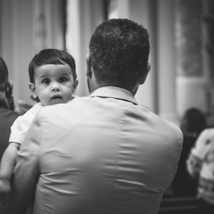 man holding baby in church