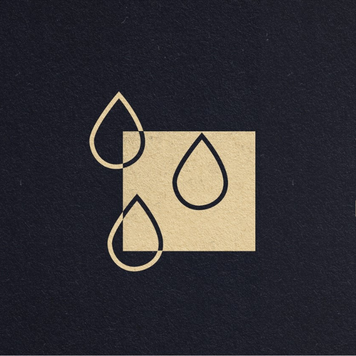three drops of water outlined on dark background